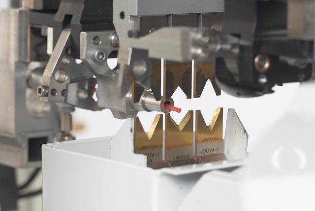 Close up of machine cutting metal.