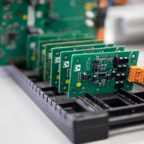 Close up of green circuit boards.