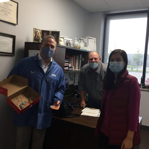 employees in an office with masks