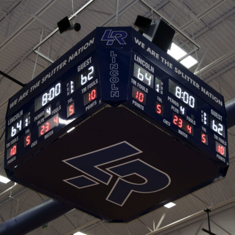 View looking up at a 4 sided basketball scoreboard showing off the high school logo LR