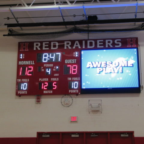 video and scoreboard side by side in a basketball gym