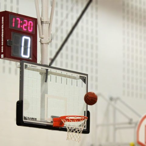 Shot Clock above an indoor basketball hoop.