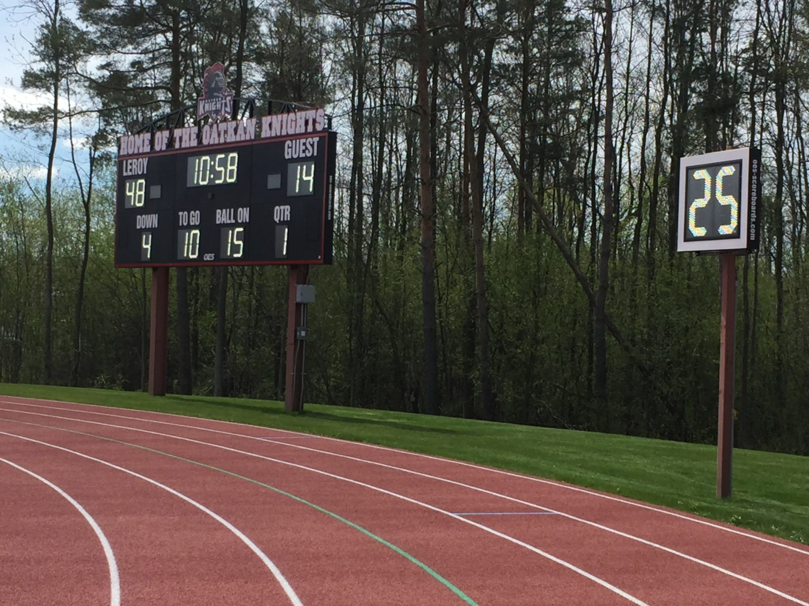 Track with scoreboard in background.