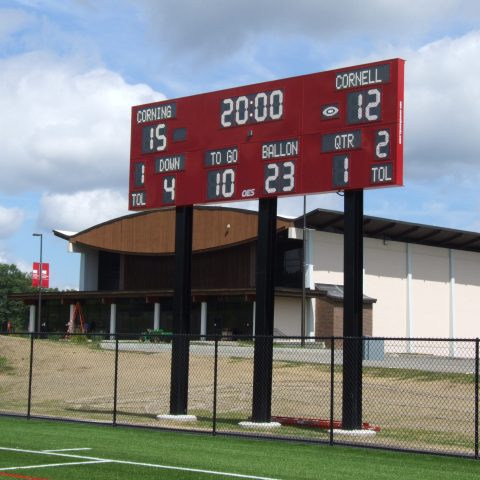 red scoreboard at outdoor playing field
