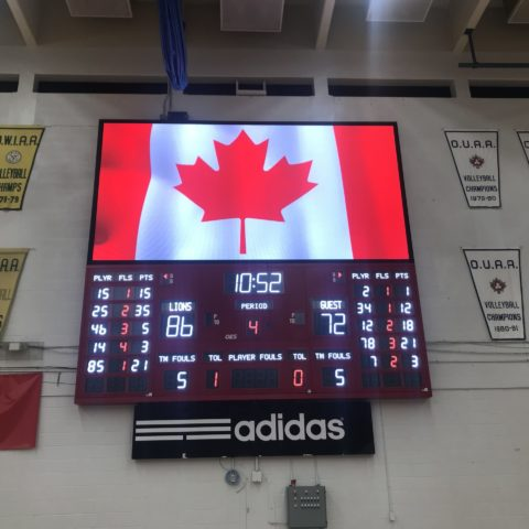 York University indoor basketball scoreboard close up.