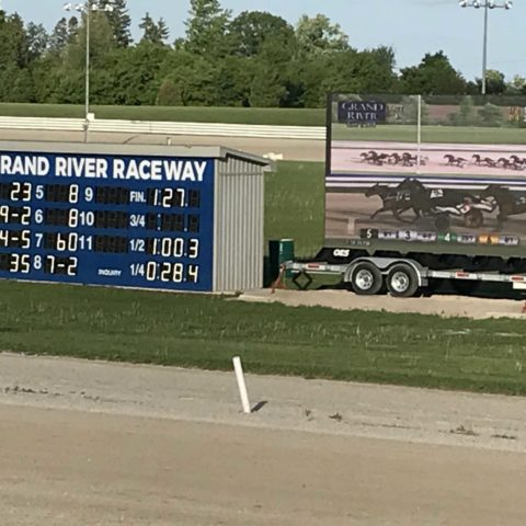 scoreboard and large full colour sign on a trailer