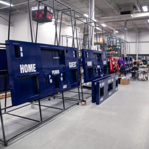 scoreboards being built in a factory