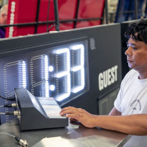 man setting up scoreboard controls