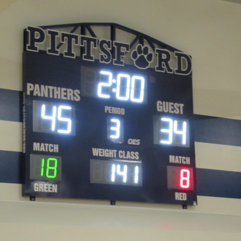 scoreboard showing results of a wrestling match