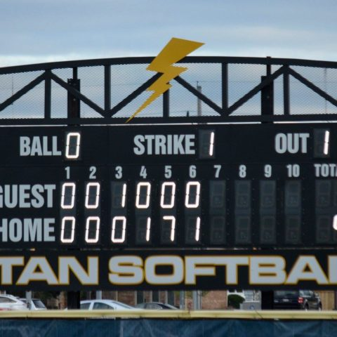 scoreboard showing the softball game score at the bottom of the 6 inning