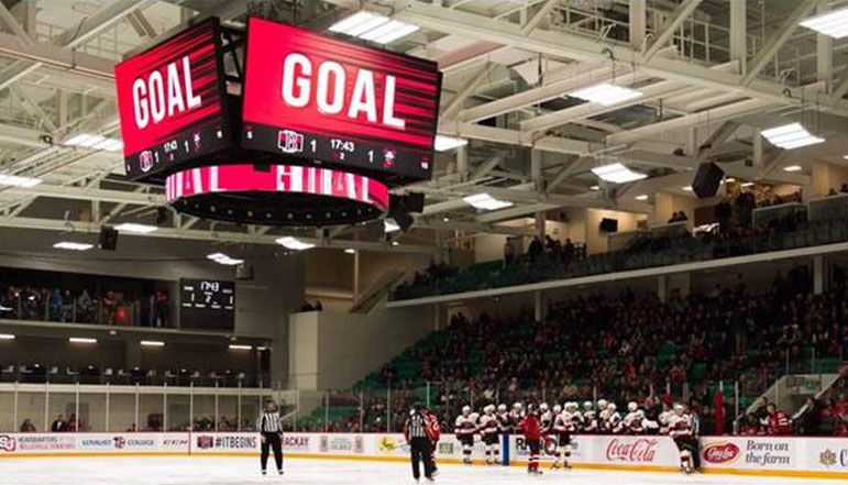 video scoreboard at centre ice is showing the work GOAL indicting a team just scored