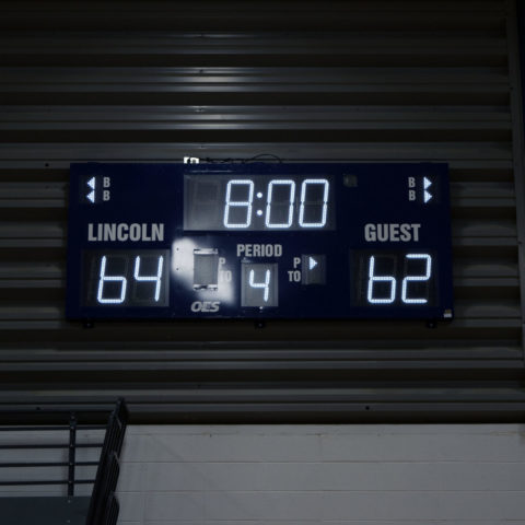 Close up of a small scoreboard with white LED digits
