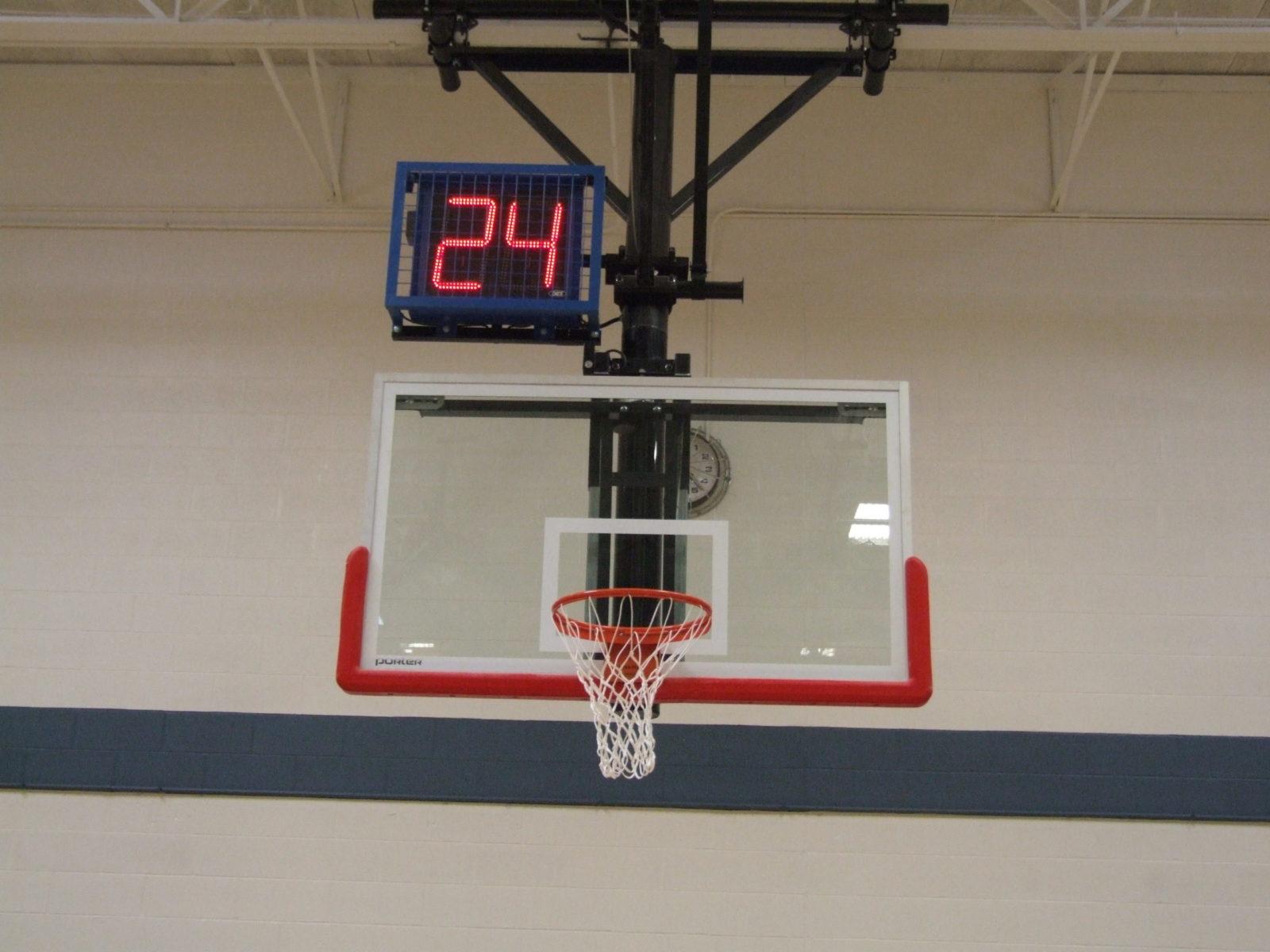 A shot clock above the basketball net.