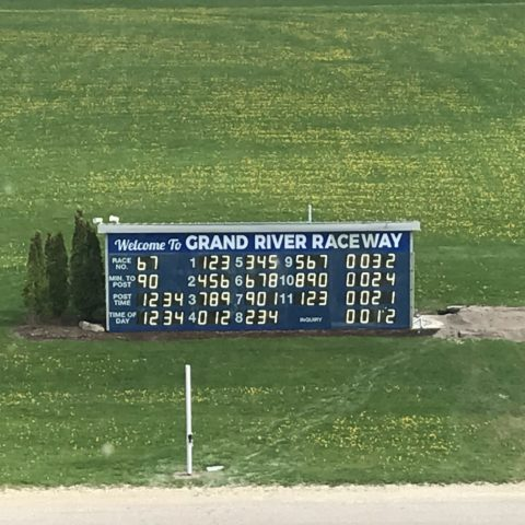a tote board at a horse race track