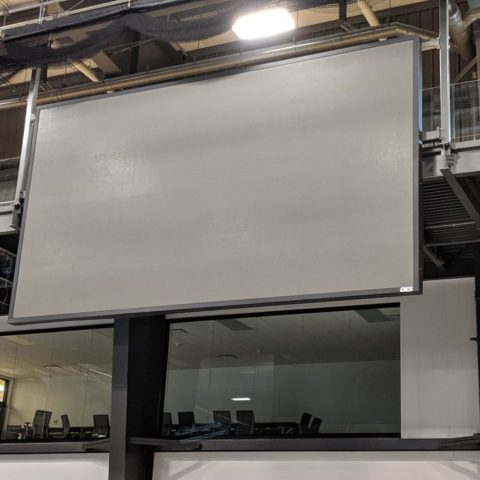 video display handing from the ceiling in an arena not turned on