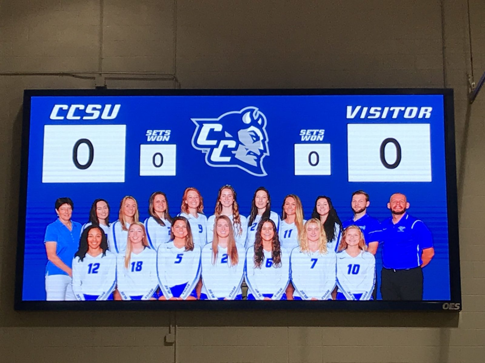 The Central Connecticut indoor scoreboard with an image of the volleyball team.