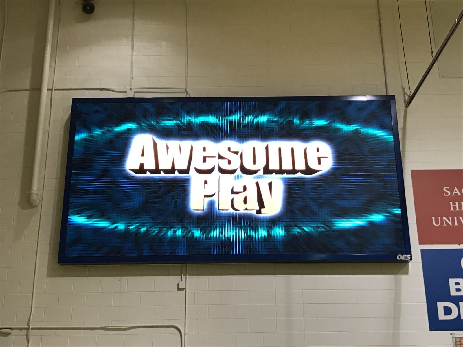 A new indoor LED scoreboard displaying the words Awesome Play.