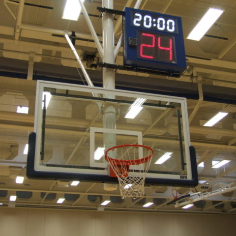 shot clock above a basketball net in a gym