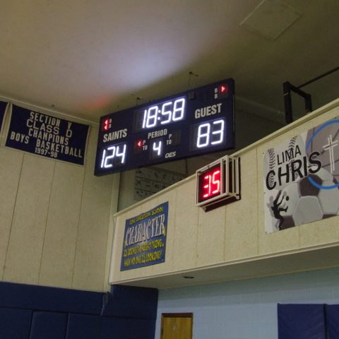 An indoor basketball scoreboard with a shot clock below.