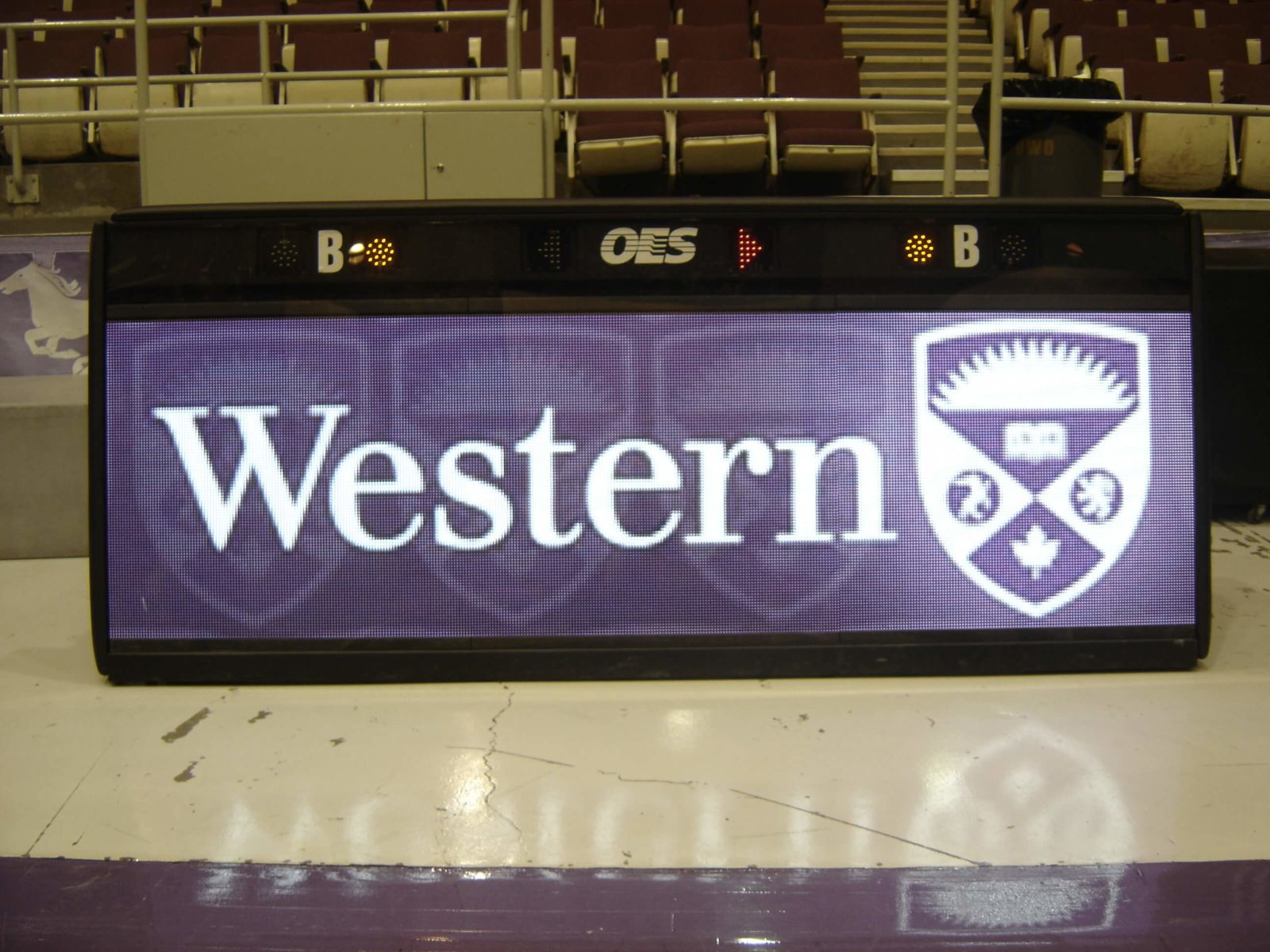 DIgital Scoreboard front with the Western University logo in purple and white .