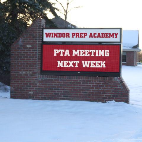 an electronic sign advertising a PTA meeting