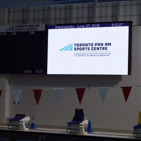 video display advertising the Toronto PamAM sports complex logo