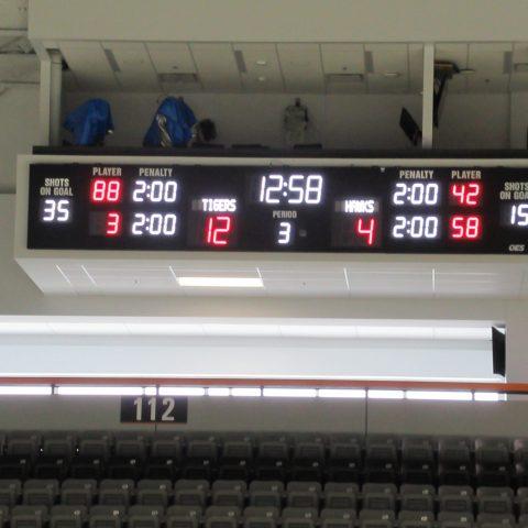 Ice hockey scoreboard under seating box
