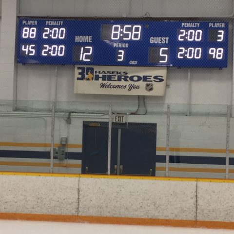 ice hockey scoreboard showing penatly times