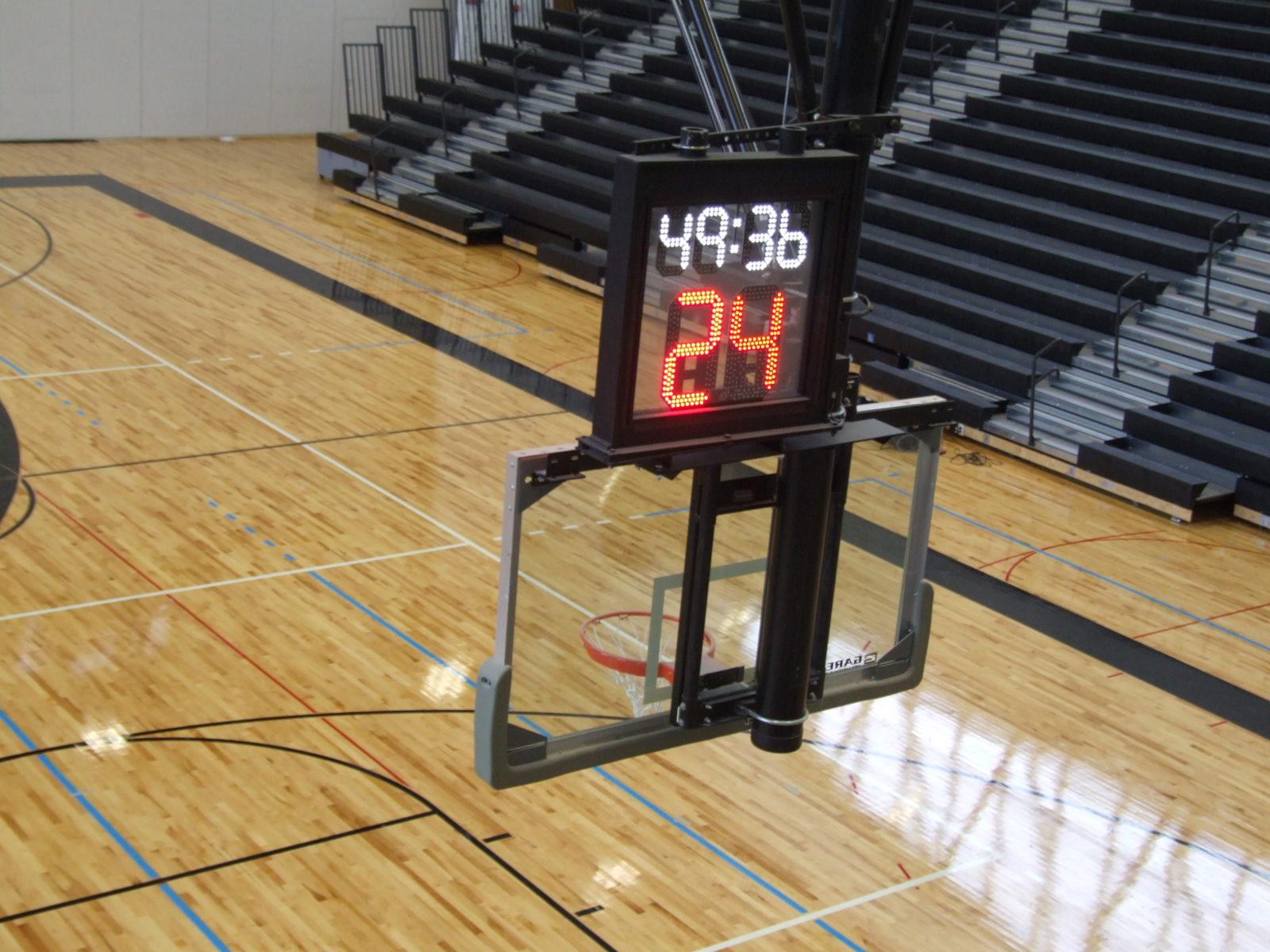 scoreboard and timer over basketball net
