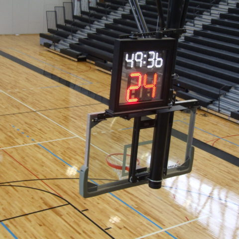 scoreboard and timer over basketball net