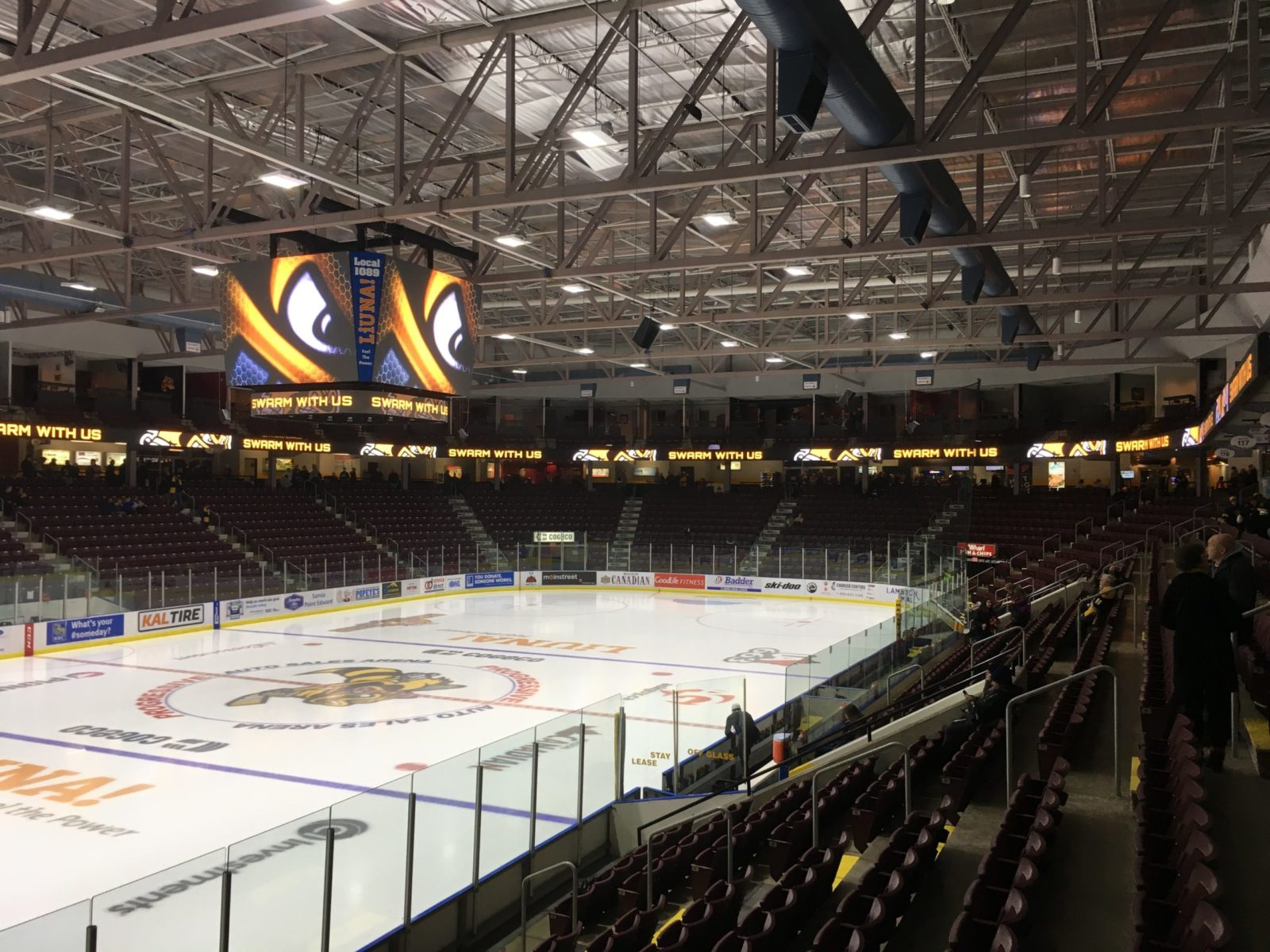 The Sarnia Stadium displaying a new OES scoreboard above a hockey rink.
