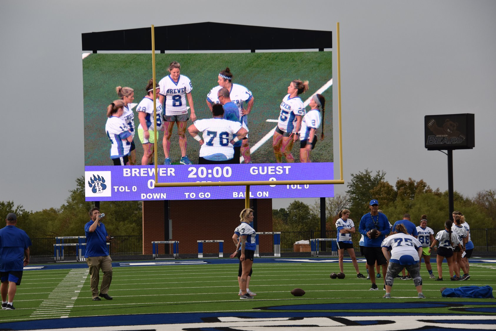 Showing female football players on a video scoreboard