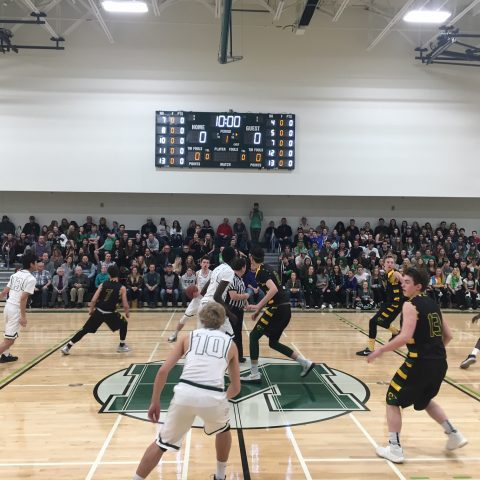 boys basketball game in action