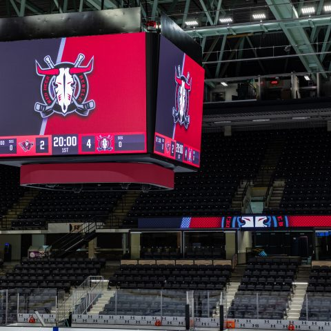video scoreboard at centre ice in an arena