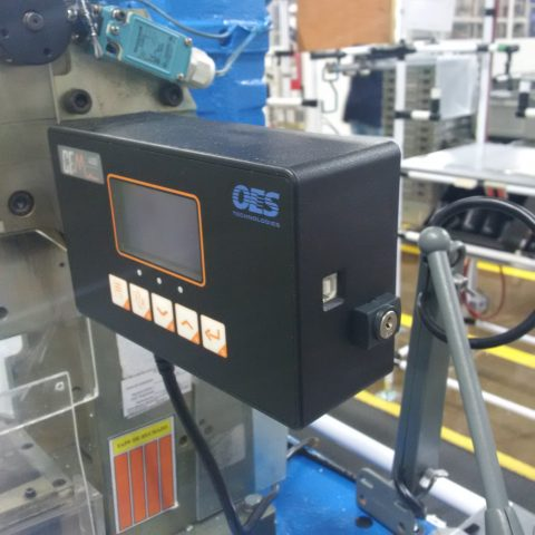 A crimp force monitor attached to a machine