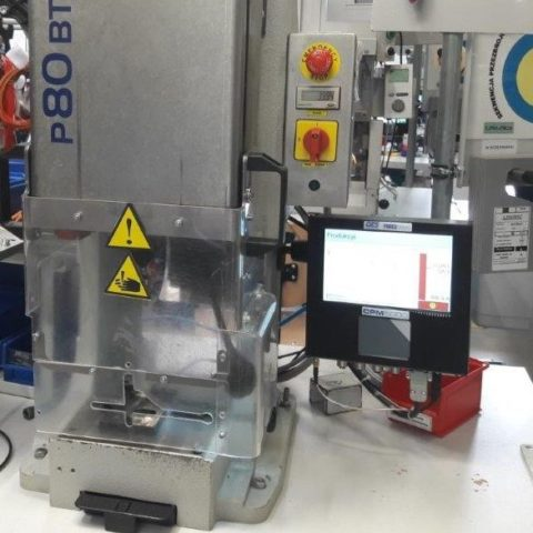 a monitor on a machine in a factory