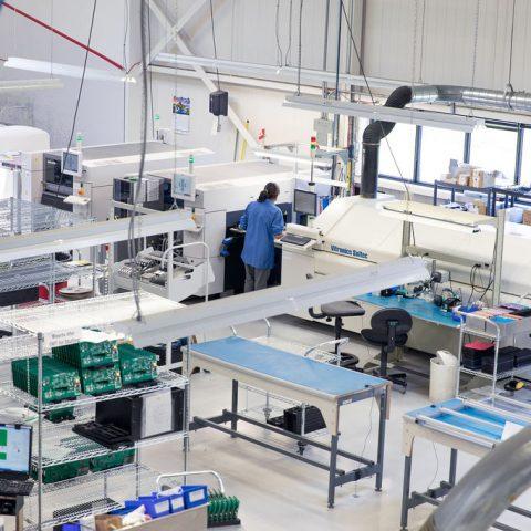 Overhead shot of women working on factory floor